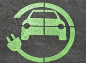 Green electric car charging sign
