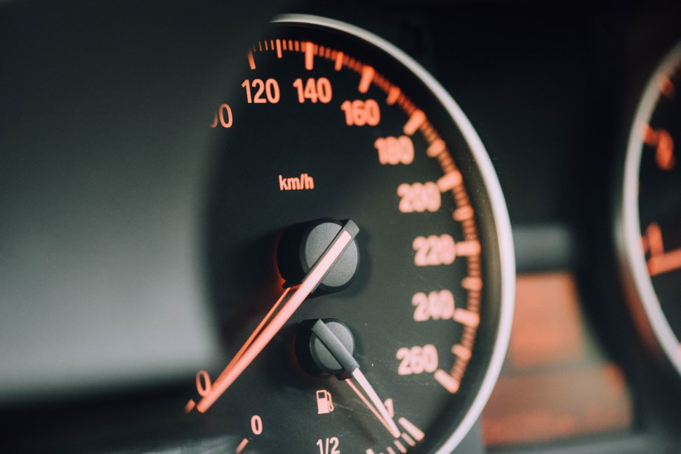 a side view over a car's dashboard with some numbers on it
